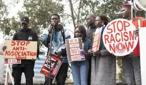 African-Australians protesting what they perceive as biased media coverage outside the Channel 7 studios in Melbourne last weekend
